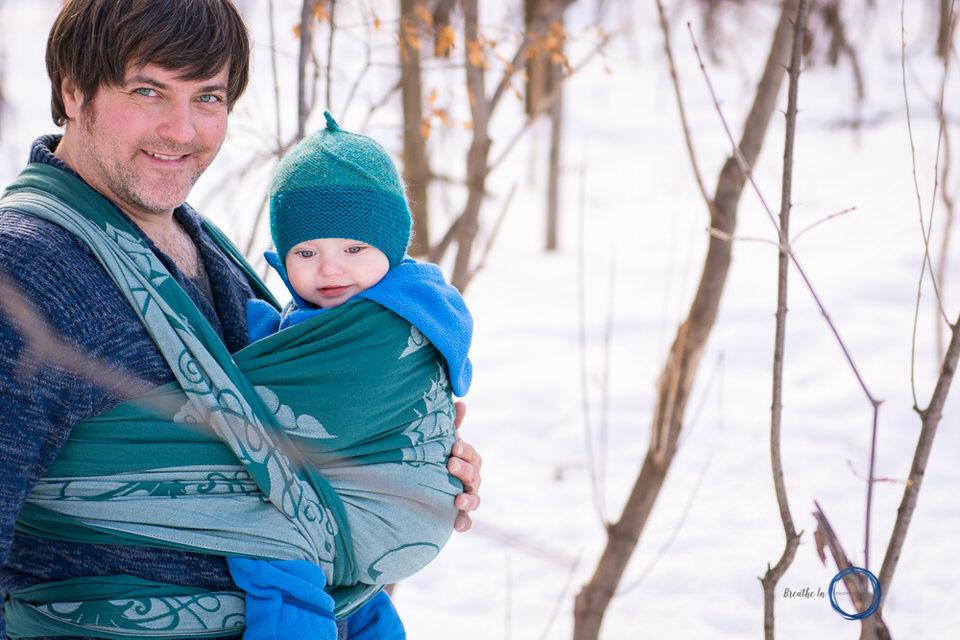 Dad babywearing in winter in Vanier.