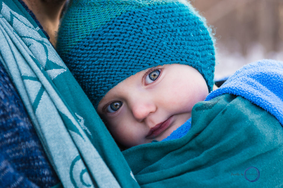 Green eyed baby in Natibaby wrap with Dad during Ottawa Babywearing Group fundraiser.
