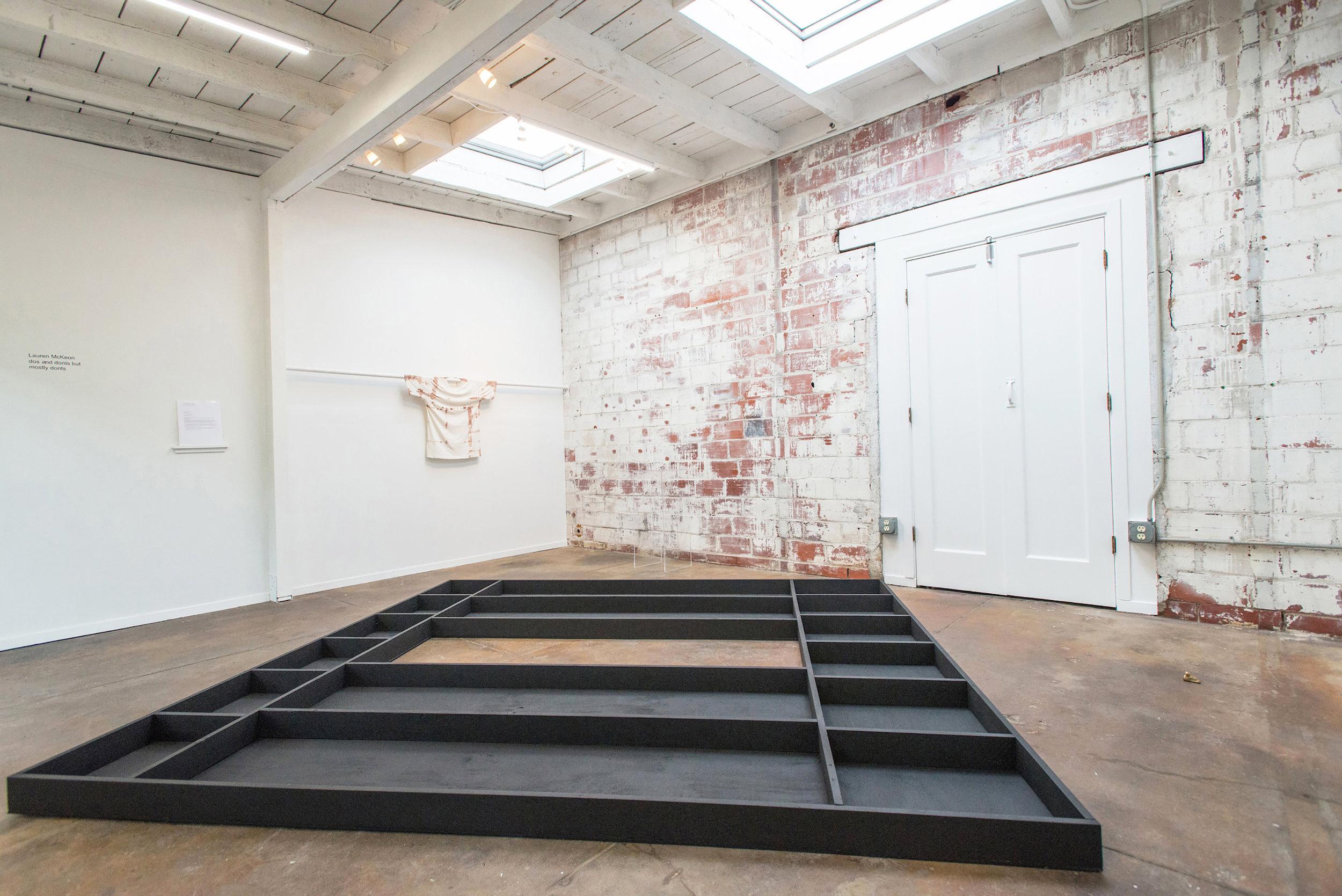 Installation View Floor piece,  Untitled  Wood, gesso 8'x9'x5'