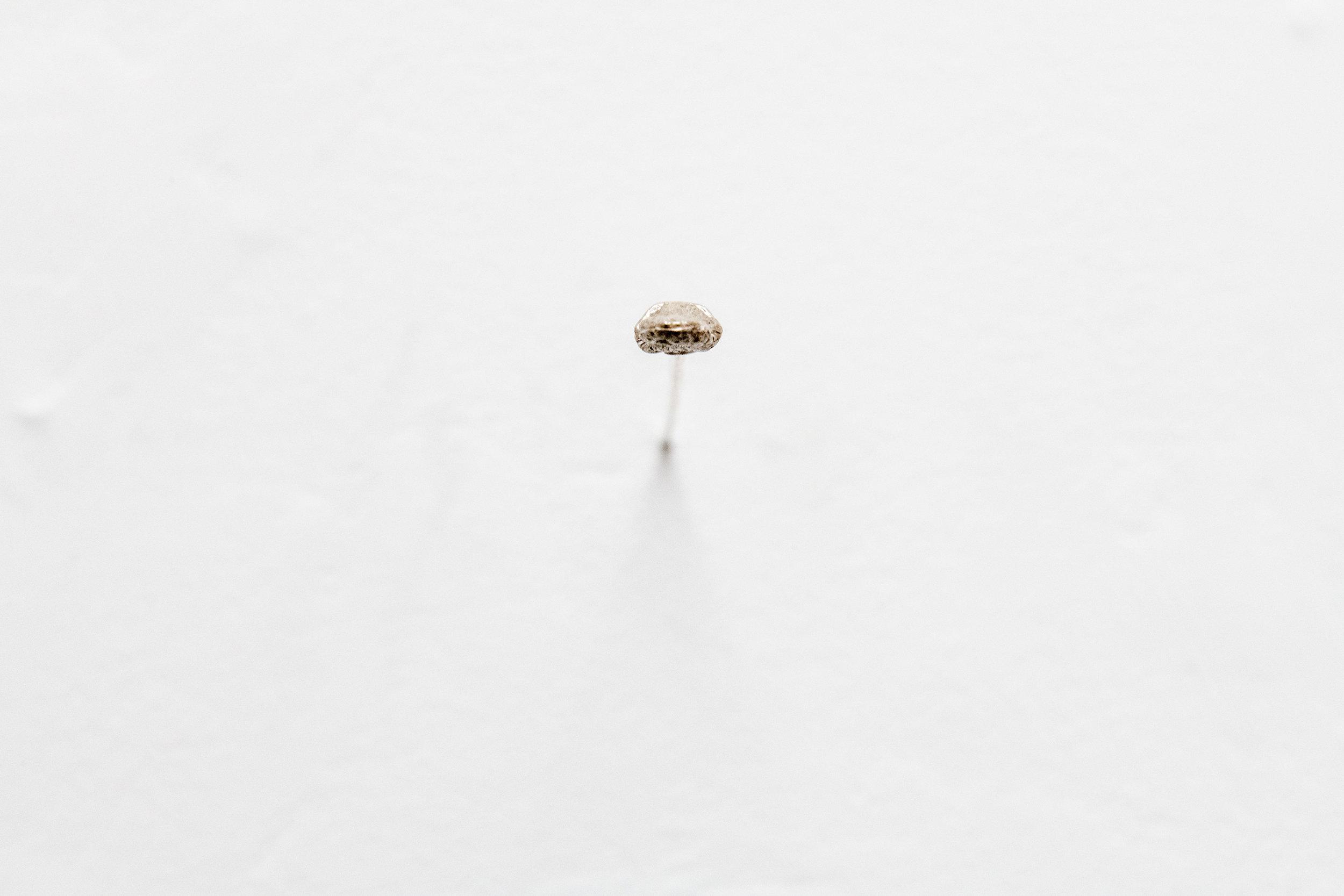 Lauren McKeon,  Psychic pressure point , 2019, sterling silver cast finger bone.