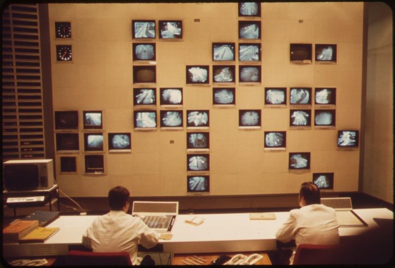 German police monitor a CCTV system in 1973. Via  Wikimedia .