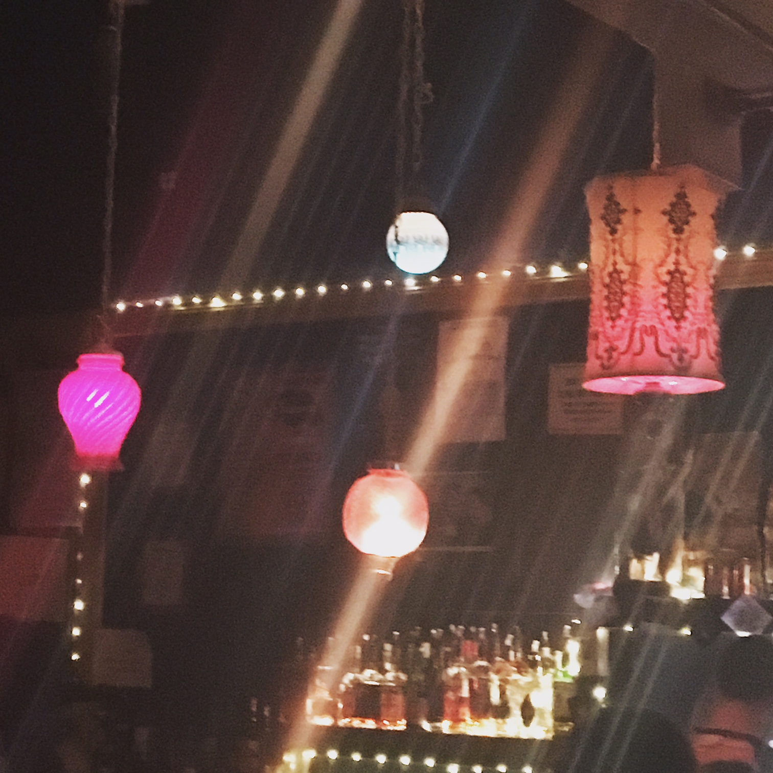 Sunnyvale's enviable collection of vintage lamps that hang above their nicely-sized bar.