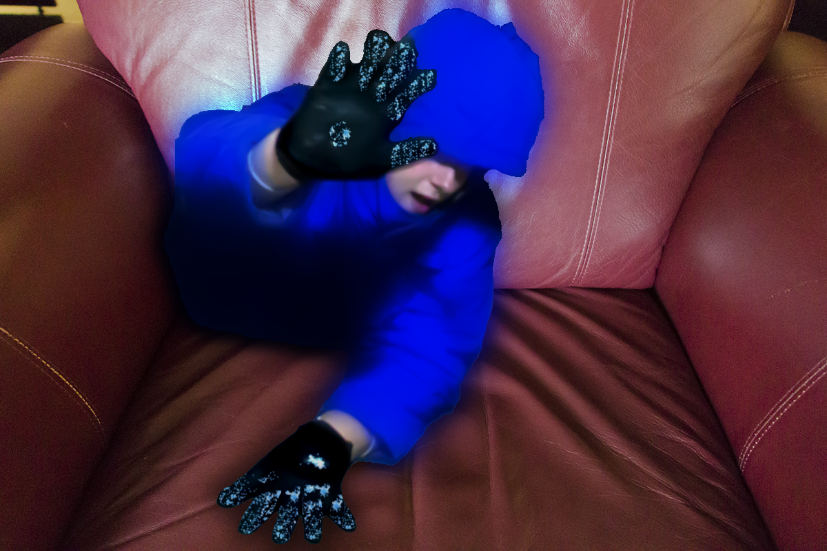 Title:  Couched  About:  DavClone #00064 had a suit malfunction while sitting in the lobby, we are still unsure of what was pulling him into the chair.