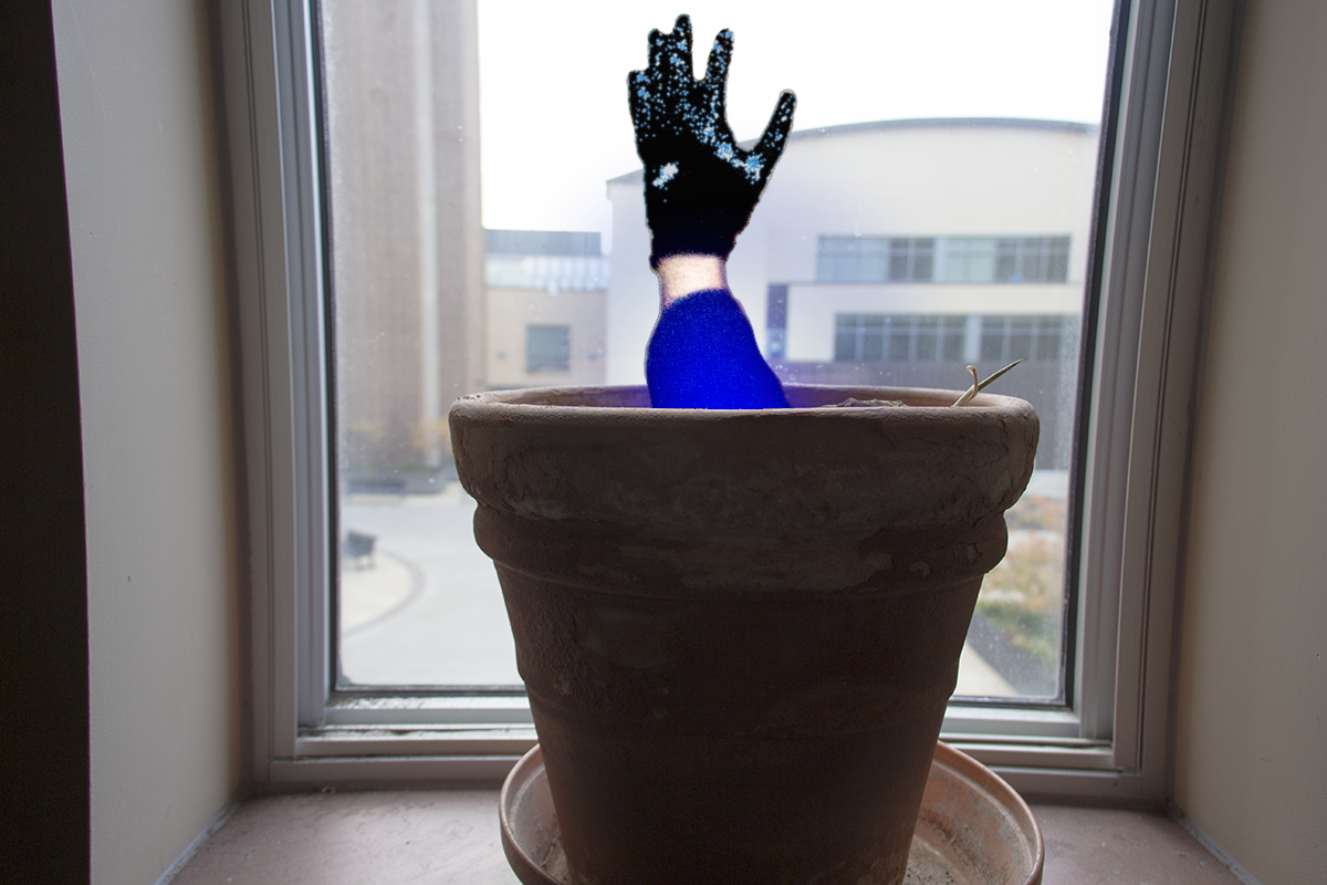 Title:  Window Planted  About:  After a mishap while testing the new shrink capabilities of the suit, the hand of DavClone #000023 became a nice new planter piece for the office.