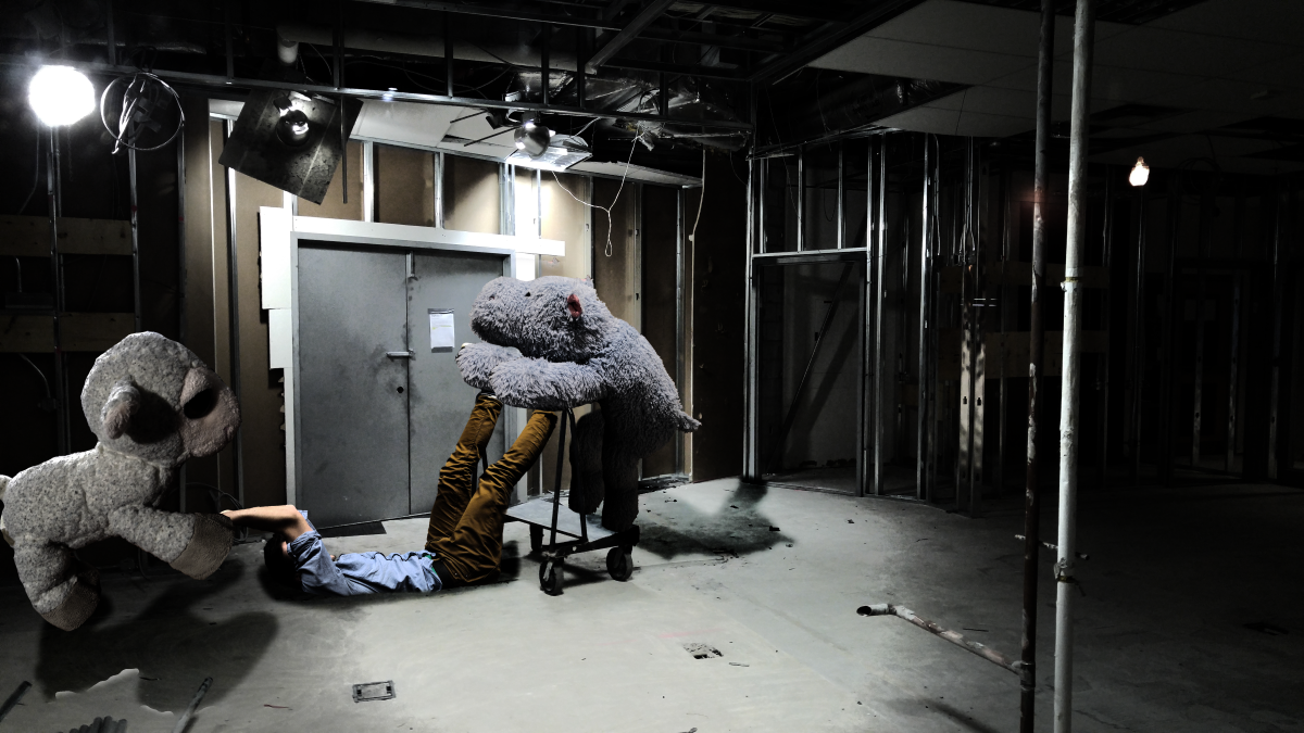 Title:  Stretcher  About:  Grant is being captured in a construction yard.