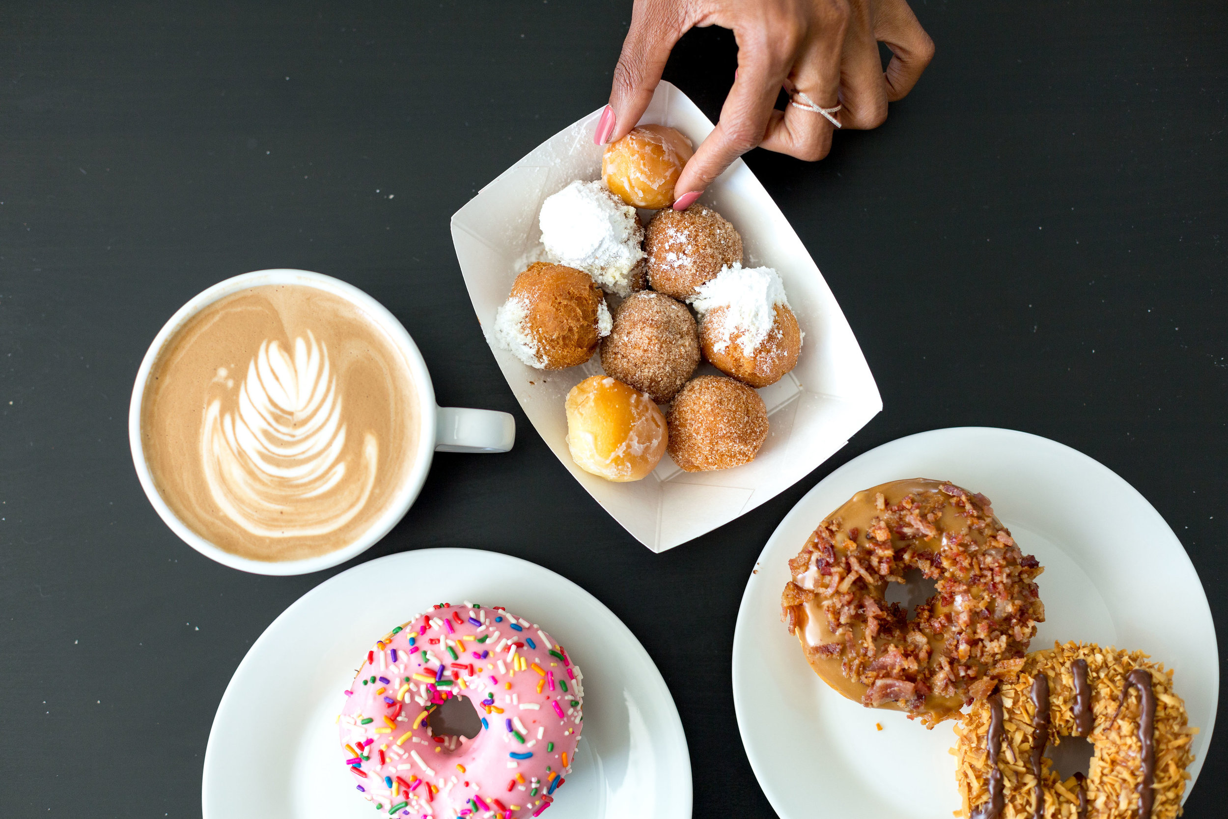 Babe's Doughnuts - pink icing, maple & bacon, samoa donuts. Donut holes are glazed, cinnamon sugar & powdered