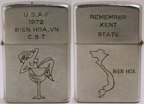 "1972 Zippo reads ""U.S.A.F. 1972 Bien , Vn C.S.T."" (Combat Survival Training) and depicts a nude girl in a cocktail glass.  The reverse says ""Remember Kent State"" and has a map of Vietnam"