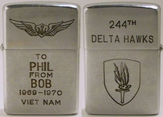 "1969 Zippo engraved with wings and ""To Phil From Bob 1969-1970 Viet Nam"".  The reverse reads ""244th Delta Hawks"" with the insignia of the 1st Aviation Brigade"
