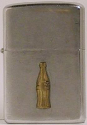 1967 Zippo with a gold-plated Coca Cola attached.