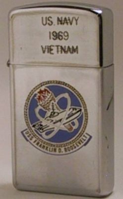 "1969 slim Zippo that reads""Navy 1969 Vietnam"" with the emblem ofUSS Franklin D. Roosevelt. The reverse reads ""TF 115"" or Task Force 115 or Operation Market Time, the effort to block the flow of arms and supplies into South Vietnam"