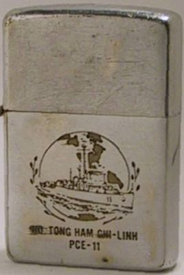"1963 Zippo reads ""Ho. Tong Ham Chi-Linh - PCE-11"" and has the image of a ship"