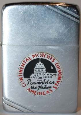 """1940-41 Zippo with a metallique logo of Continental Motors with the slogan """"Powerful as the Nation"""". Continental Motors Company was a manufacturer of internal combustion engines. Founded in 1905 the company produced engines for many independent manufacturers of automobiles, tractors, trucks, and stationary equipment (such as pumps,generators, and industrial machinery drives) through the 1960's."""