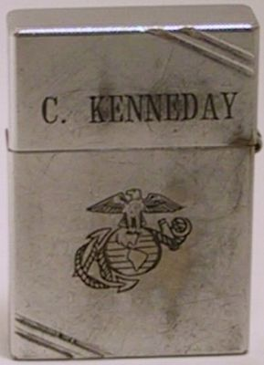 """This is a 1936-40 Zippo with diagonal lines engraved with a line-drawn US Marine Corp logo and """"C. Kenneday"""" on the lid. The is one of the earliest Zippos with a military-related engraving."""