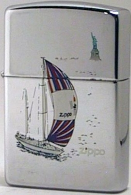 1992 Zippo with a sail boat and the Statue of Liberty. Thislighter is an advertiser for Zippo Mfg. itself