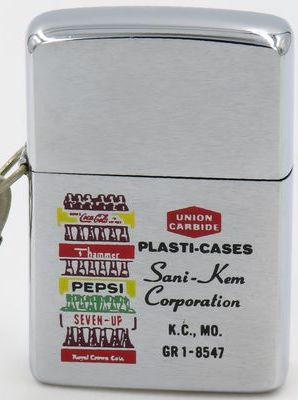 1964 Zippo adverising plasti-cases for Sani-Kem Corporation with a graphic of a stack of cases of soft drink bottles, including Coca-Cola, Pepsi, Seven-Up and Royal Crown Cika