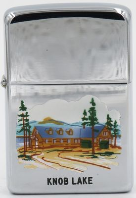 1956 Town & Country Zippo depicting a log cabin and pine trees at Knob Lake