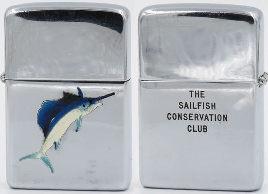 "1956 Town & Country Zippo with the graphic of a sailfish.  The enamel on the head of the fish was damaged and has been repaired.  The reverse reads ""The Sailfish Conservation Club"" which at one time awarded Zippo lighters to anglers who tagged and released sailfish"