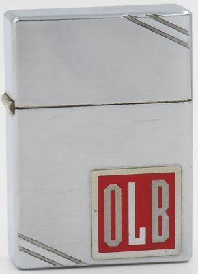 "1936 metallique Zippo with the initials ""OLB"""