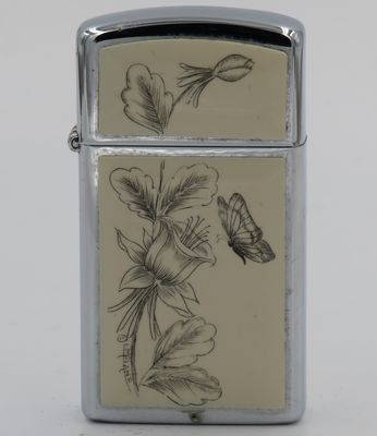 1980 slim Zippo with butterfly and flowers scrimshawed by Lois McLane