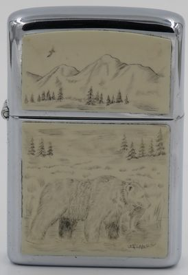 1980 Zippo with a grizzly bear scrimshawed by Lois McLane