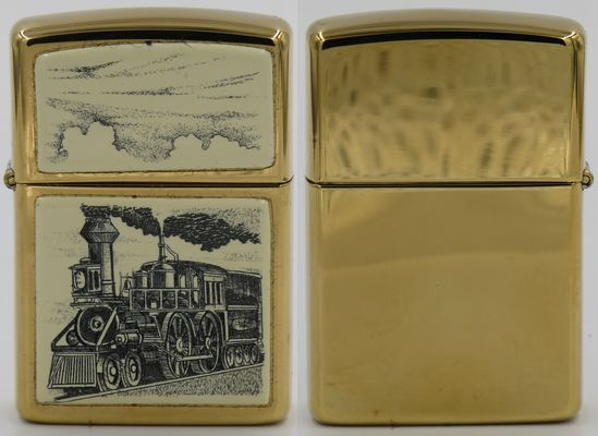 1991 Zippo with a Scrimshawdesign on onrushing locomotive. It is unusual for a scrimshaw Zippo not to have acrylic panels on both sides. This locomotive design is rare