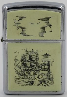 1988 scrimshaw Zippo with the popular Tall Ship & Lighthouse design