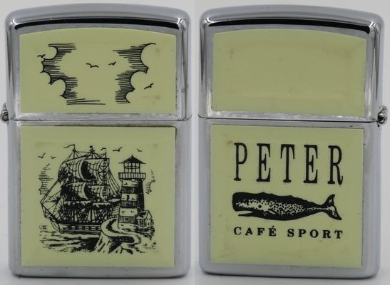 1991 Scrimshaw Zippo with Tall Ship & Lighthouse design on one side and advertising for Peter Café Sport, a popular fishermens' bar in Horta, Portugal