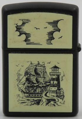 1993 Scrimshaw Zippo with the Tall Ship & Lighthouse design on a black case.