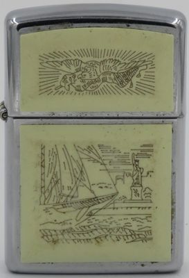 1993 scrimshaw Zippo with sailing ship, the Statue of Liberty and a patriotic eagle on the lid