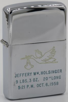 1958 Zippo with baby carrying stork announcing the birth of Jeffrey Wm.Holsinger with his birthdate, weight and height. Bob Holsinger was a foreman at Zippo