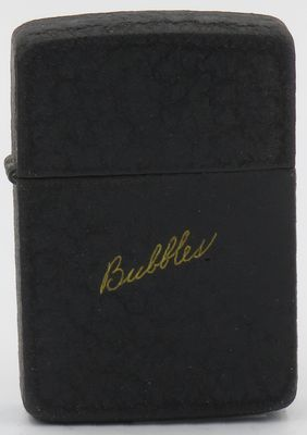 """1942 World War II back crackle Zippo with gold """"Bubbles"""" inlay. Bubbles is reportedly LaRue Hutton, nice of Dale Hutton, long term Zippo employee. This lighter appears in David Poore's book """"Zippo The Great American Lighter""""."""