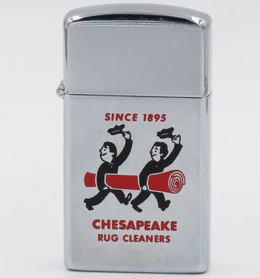 1959 slim Zippo with a graphic of two hat-tipping carpet-carrying men which was used by Chesapeake Rug Cleaners of Baltimore, Maryland