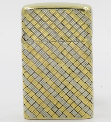 18K gold Cartier lighter with slim Zippo insert. Cable knit design in white and yellow gold