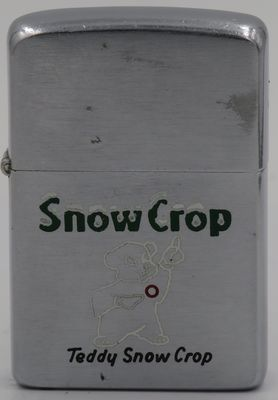 1958 Zippo with Snow Crop's friendly polar bear Teddy. Snow Crop is an orange juice and lemonade brand owned by the Coca-Cola Company