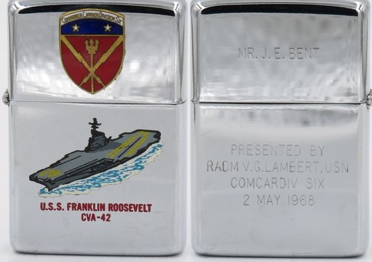 1967 T&C Zippo for the carrier USS Franklin Roosevelt with attached badge Commander Carrier Division Six. On the reverse, the name Mr. J.E. Bent on the lid. Presented by R. Adm. V.G. Lambert USN ComCarDiv Six, 2 May 1968