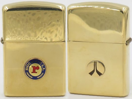 "14K gold Zippo with attached badge-logos of Rockwell International, a major conglomerate founded in 1919 by Willard Rockwell. The Zippo dates from the late 1960's and has the initials ""WEF"" engraved on the lid"