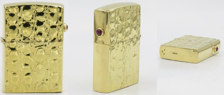 18K gold Gucci lighter with a Zippo insert  and a ruby gem stone attached