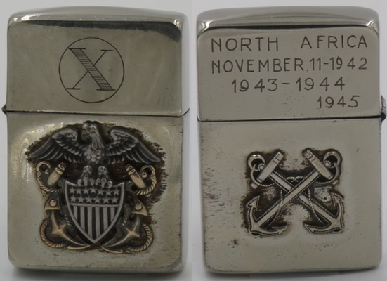 """This interesting Zippo has a Naval officer's cap badge attached on one side Boswain's mate emblem and """"North Africa November 11, 1942 1943-1944-1945"""" on the other"""