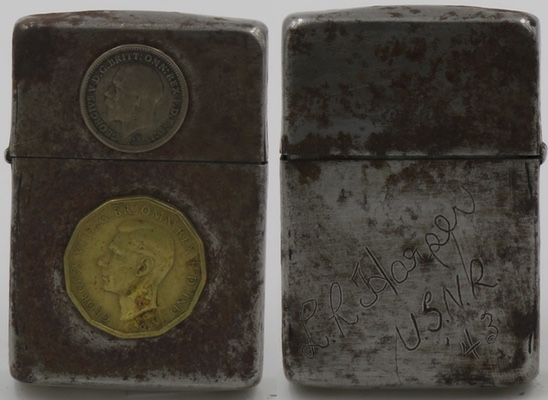 """A 1942-45 trench art Zippo with English coins. The reverse barely visible reads """"L.R. Harper USNR '43"""" The rough surface is typical of the steel Zippos of that period."""