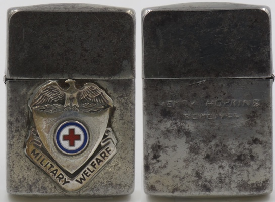 """This 1941 Zippo has a """"military welfare"""" emblem and a Red Cross. During WWII, over 7.5 million Americans got involved with the Red Cross. The reverse reads """"Henry Hopkins Rome 1944"""""""