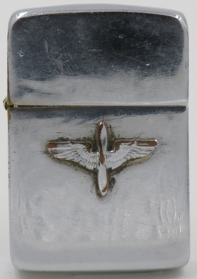 """1940-41 Zippo with the """"prop and wings"""" insignia of the Army Air Service, a forerunner of the United States Air Force"""