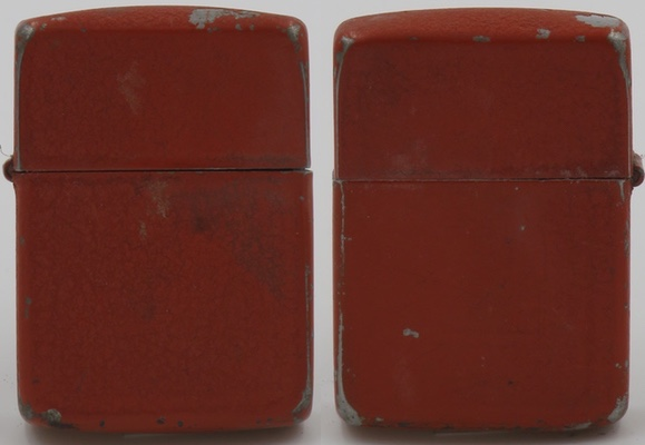 """This is a rare """"red crackle"""" Zippo. Presumably these were preferred by soldiers in tanks because they were easier to find in the darkness of the tank's interior"""