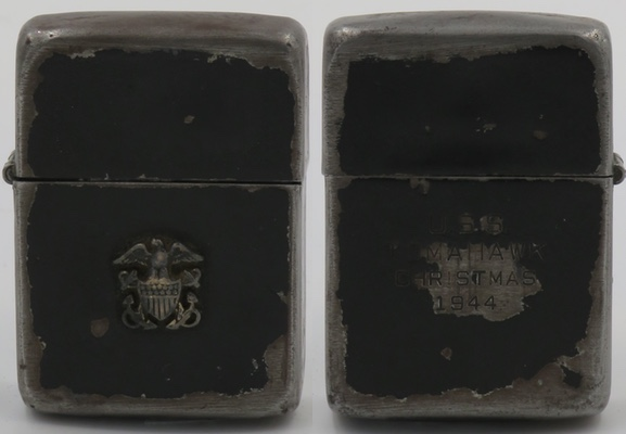 """1942-45 black crackle Zippo with the emblem of the US Navy attached to the front and the inscription """"USS Tomahawk Christmas 1944"""" on the reverse"""