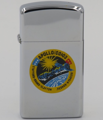 The Apollo-Soyuz Test Project was the first human spaceflight mission managed jointly by two nations, the US and the Soviet Union. In 1975 it achieved its goal of rendezvous and docking of human spacecraft. The slim Zippo is from 1974
