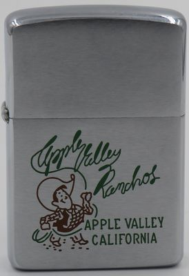 1958 Zippo with a graphic of a lasso swinging cowboy in a 10 gallon hat advertising Apple Valley Ranchos, a water company serving Apple Valley, California