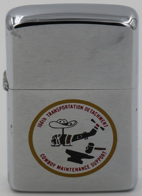 1967 Zippo for 166th Transportation Detachment Cowboy Maintenance Support with an anvil and helicopter wearing a cowboy hat