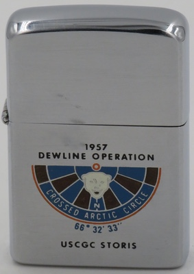 """1957 Zippo for the   light icebreaker and medium endurance cutter  USCGC Storis commemorating its role in the """"1957 Dewline Operation - Crossed the Arctic Circle"""" The DEW line was a """"Distance Early Warning"""" line of telecommunications stations across the Arcticto provide the earliest possible warning of aircraft passing the polar route"""