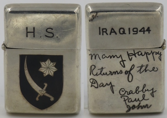 """Sterling silver lighter with a Zippo insert. It has the initials HS on the lid and the case has the emblem of the US Army's Persian Gulf Command, established in 1943 to assure the supply of U.S.war material to the Soviet Union. The reverse reads """"Iraq 1944"""" and """"Many Happy Returns of the Day - Crabby, Paul, John"""""""