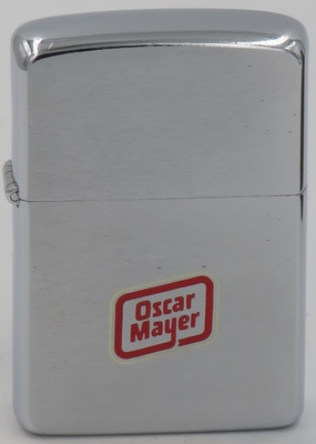 1960 Zippo for Oscar Mayer. With its origins in 1883,The Oscar Mayer Company is an American meat and cold cut production company, owned by Kraft Heinz. It is known for its hotdogs,bologna,bacon,ham and Lunchables products