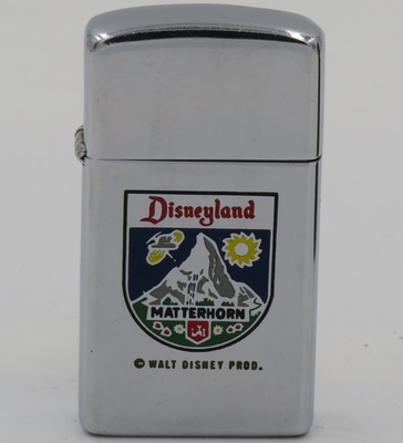 1959 slim Zippo commemorating the opening of the Matterhorn Bobsled ride in Disneyland. The Matterhorn Bobsleds open as the first steel roller coaster in the world
